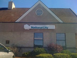 National City acquisition by PNC - The National City branch in Shenango Township, Pennsylvania near New Castle on September 19, 2009 just before its conversion to PNC Bank, complete with the new PNC sign being covered up by tarpaulin with the National City logo. This National City branch (originally an Integra Bank branch before their acquisition by National City in late 1995) was one of the few National City branches in Western Pennsylvania that PNC wasn't required to divest by order of the United States Department of Justice.