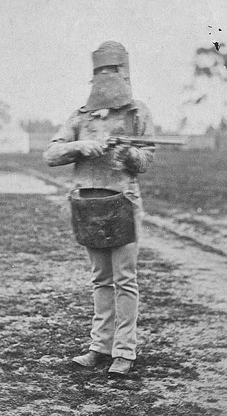 Joe Byrne - Photograph taken on 5 July 1880 of a policeman equipped with Byrne's helmet and Ned Kelly's rifle and skull cap.