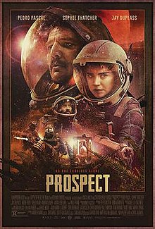 The red-tinted poster shows multiple characters in environmental suits with glass-opening helmets in various close-ups.