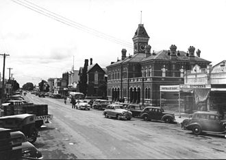 Shepparton - Wyndham Street in 1951. The Shepparton Post Office and tower (built 1882) was the city's major landmark. Urban renewal from 1966 onwards has resulted in the replacement of all buildings pictured.