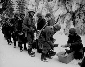 8th Armored Division (United States) - US soldiers in the Netherlands, January 1945, showing the conditions men of the 8th had to contend with in their march across France and the Low Countries.