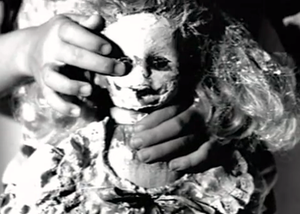 Doll Parts - Doll symbolism and a child resembling Kurt Cobain are prominent in the song's music video