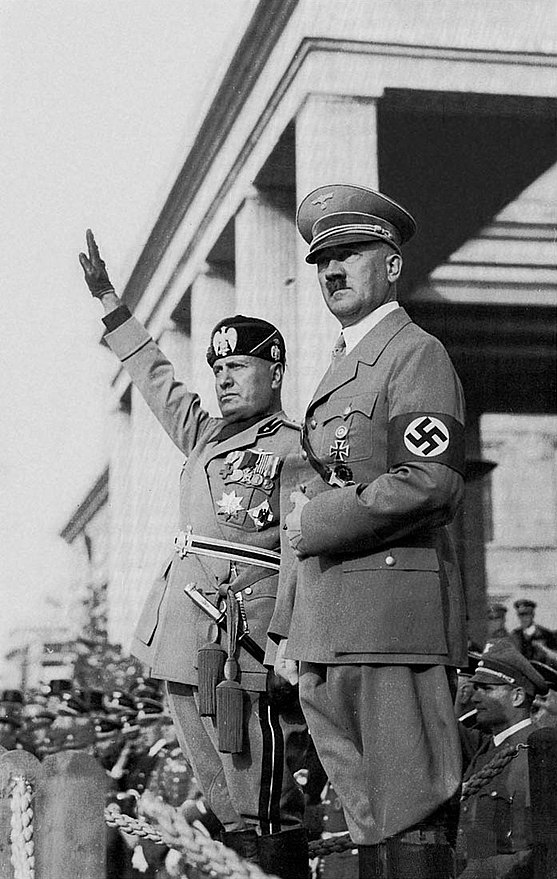 "From left to right: Benito Mussolini and Adolf Hitler. Hitler's policies and orders both directly and indirectly resulted in the deaths of about 50 million people in Europe. Together with the Soviet regime of Joseph Stalin, they have marked the inception of the ""totalitarian regimes"". Hitlermusso2 edit.jpg"
