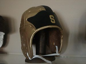 Winged football helmet - A full-size replica of the 1933 Michigan State gold and black winged helmet