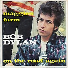 Single sleeve of Dylan in a blue jacket staring at the camera with a person standing behind him, his name and large song titles.
