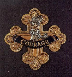 Cowardly Lion - Cowardly Lion's courage medal used for the 1939 film.