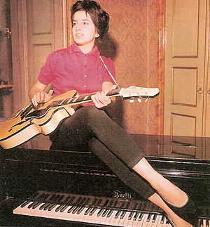 Mina (Italian singer) - With her Anelli piano and a Giemmei guitar at home in Cremona, 1959