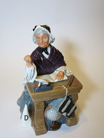 Schoolmarm, a figurine by Royal Doulton Schoolmarm, a figurine by Royal Doulton.jpg