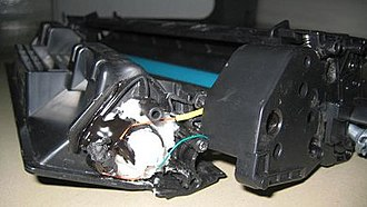 Cargo planes bomb plot - A toner cartridge from one of the recovered bombs showing white powder and wiring