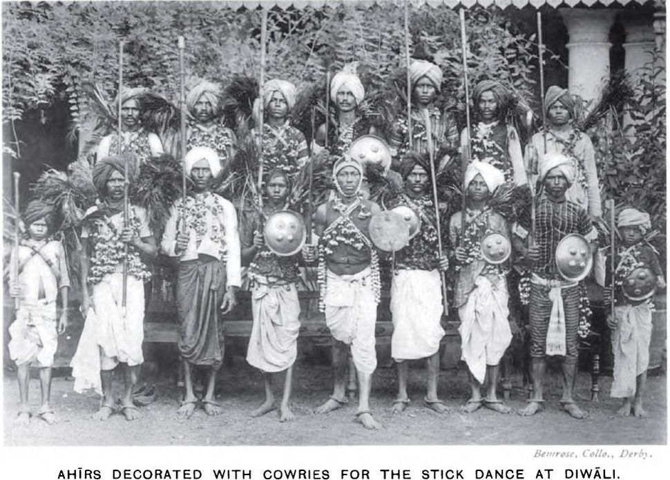 Photograph (1916) of Ahir (now Yadav) dances dressed in cowrie shells for the stick dance at Diwali