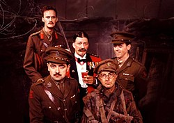 The main members of the cast of Blackadder Goes Forth are seated in the production's World War I trench set. Seated in the centre is Stephen Fry as General Melchett, incongrously wearing red officer's mess dress and holding a sherry. Tim McInnerny as Captain Darling and Hugh Laurie as Lieutenant George stand beside him in green officers' uniforms. Most prominent in the picture is Rowan Atkinson as Captain Blackadder, wearing his captain's uniform. To his right is Tony Robinson as Baldrick, wearing a moth-eaten private's uniform, his cap angled off-centre. George is the only one smiling.