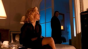 "Bad Girl (Madonna song) - Madonna as ""Louise Oriole"" in the ""Bad Girl"" music video. Also present in the background is actor Christopher Walken as Madonna's guardian angel."