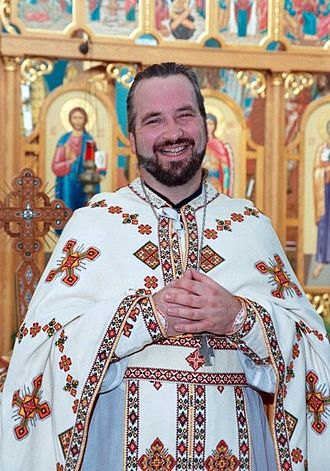 Vestment - Ukrainian Catholic priest wearing sticharion, phelonion, epitrachelion, zone, epimanikia, and pectoral cross at a church in the United States.