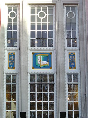 Heal's - The sign of the four poster on the façade of the Tottenham Court Road store.