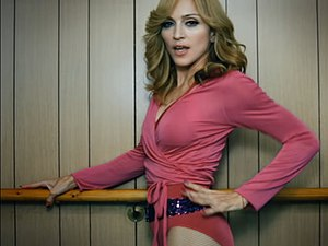 "Hung Up - Madonna wearing a pink leotard while dancing in the ballet studio in the John Travolta and retro inspired ""Hung Up"" video."