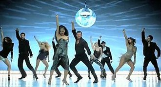 Hush Hush; Hush Hush - The Pussycat Dolls and their male partners dancing in front of a disco mirror ball.
