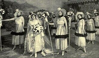 Katinka (operetta) - May Naudain as Katinka surrounded by her bridesmaids in the Act 1 wedding scene
