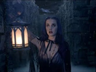 "Wide Awake (song) - Perry as she explores a crepuscular labyrinth with a lantern in the music video for ""Wide Awake""."
