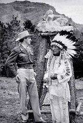 Korczak Ziolkowski and Henry Standing Bear with Thunderhead Mountain, site of Crazy Horse Memorial, in the background and Ziolkowski's monument sculpture model immediately behind them. The photo was taken before work on Thunderhead Mountain was begun in 1948.
