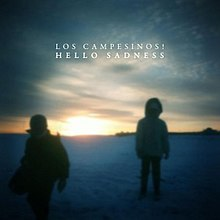 "A blurred photograph of two people in thick jackets standing in snow with a sunset in the background. Near the top of the image are the words ""LOS CAMPESINOS!"" and below that ""HELLO SADNESS""."