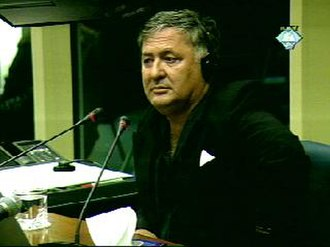 Center for Justice and Accountability - CJA plaintiff Kemal Mehinovic testifies at the Hague.