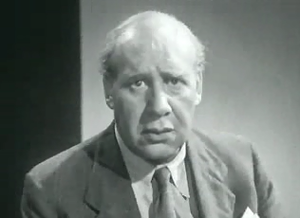 "Richard Massingham - Screenshot from ""Coughs and Sneezes"" a 1945 PIF directed by, and starring Richard Massingham."