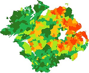 Ulster Protestants - Percentage of Protestants in each electoral division in Ulster, based on census figures from 2001 (UK) and 2006 (ROI). 0-10% dark green, 10-30% mid-green, 30-50% light green, 50-70% light orange, 70-90% mid-orange, 90-100% dark orange.