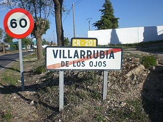 Reassurance marker - A simple identification sign attached to a town exit sign in Villarrubia de los Ojos, Ciudad Real, Spain