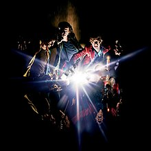 A painting of the band members with an explosion of light in the center