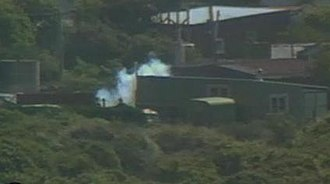 Aramoana massacre - Armed police search cribs in Aramoana for David Gray, November 14.
