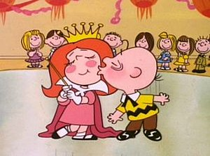 It's Your First Kiss, Charlie Brown - Charlie Brown kisses the Little Red-Haired Girl.