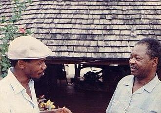 George Lilanga - George Lilanga (right) and Patrick Francis outside Nyumba ya Sanaa