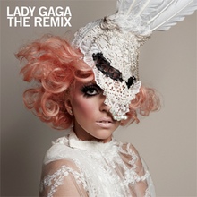 Lady Gaga's face covered in white lace and feathers