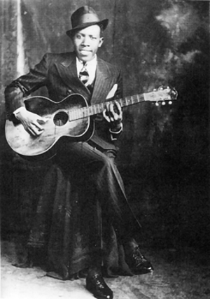 Robert Johnson - Studio portrait (ca. 1935), one of only two or three verified photographs of Johnson
