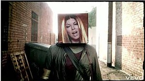 "The Time (Dirty Bit) - A cubic projection of Fergie materializing in place of will.i.am's head in the music video for ""The Time (Dirty Bit)""."