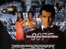 "A man wearing an evening dress holds a gun. On his sides are a white woman in a white dress and an Asian woman in a red, sparkling dress holding a gun. On the background are monitors with scenes of the film, with two at the top showing a man wearing glasses holding a baton. On the bottom of the screen are two images of the 007 logo under the title ""Tomorrow Never Dies"" and the film credits."