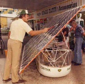 The Quiet Achiever - The Quiet Achiever team working on the car's photovoltaic array.