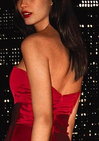 A brunette, female model in a red dress