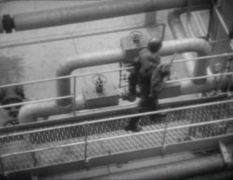 Rudolph Cartier - A Cartier location shot from Quatermass II (1955), looking down from one of the towers of the Shell Haven oil refinery. Such ambitious location work was new to British television.