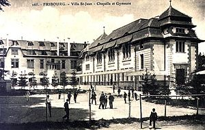 Villa St. Jean International School - Buildings near the northern end of the campus in 1909 with students playing in the foreground.