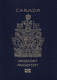 "A navy blue passport cover with a gold-coloured crest. Text reads ""CANADA"" above the crest and ""PASSPORT"" and ""PASSEPORT"" below"