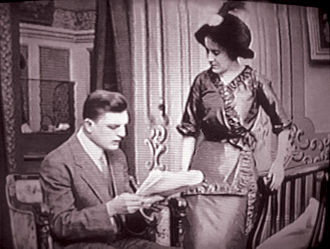 Dorothy Gibson - Dorothy Gibson and Lamar Johnstone in a scene from the comedy, The Lucky Hold Up (1912). The film was released April 11, 1912 while Gibson was on the RMS ''Titanic''
