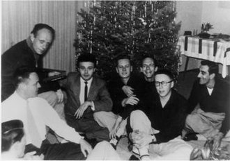 Mattachine Society - Members of the Mattachine Society in a rare group photograph. Pictured are Harry Hay (upper left), then (l–r) Konrad Stevens, Dale Jennings, Rudi Gernreich, Stan Witt, Bob Hull, Chuck Rowland (in glasses), Paul Bernard. Photo by James Gruber.