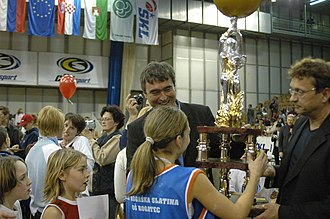 School Basketball League - Slovenian minister of education dr. Milan Zver and CEO of Zavod ŠKL Vojko Korošec presenting the trophy to primary school winners