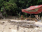 The tribe camp near the end of Survivor: Borneo.  Tribes must build themselves primitive shelters from natural resources and through reward items earned during the competition.