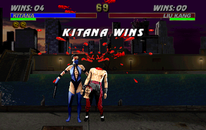 Ultimate Mortal Kombat 3 - Kitana performing a decapitation Fatality finishing move on Liu Kang