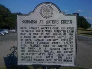 Skirmish at Waters Creek - A historical sign with information about the skirmish