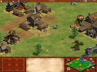 Age of Empires II - The Celtic civilization in the Feudal Age. The Town Center is visible and has several farms surrounding it; villagers of both sexes work there and elsewhere to gather resources. A scout on horseback is also at the ready. Military buildings such as the barracks, archery range, and stable are visible, as well as economic buildings—the market, blacksmith and mill. The right-bottom corner of the screenshot shows the player's walls and a gate.