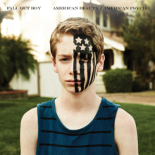 An image of a teen standing near a house, with the black American flag on one side of him. We see the band's name and the album title written above in black.