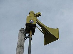 National Emergency Alarm Repeater - Civil Defense logo on a Thunderbolt 1003 siren.